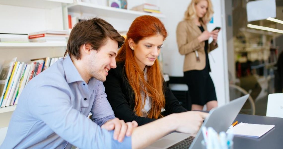 Business people brainstorming in white modern office at desk