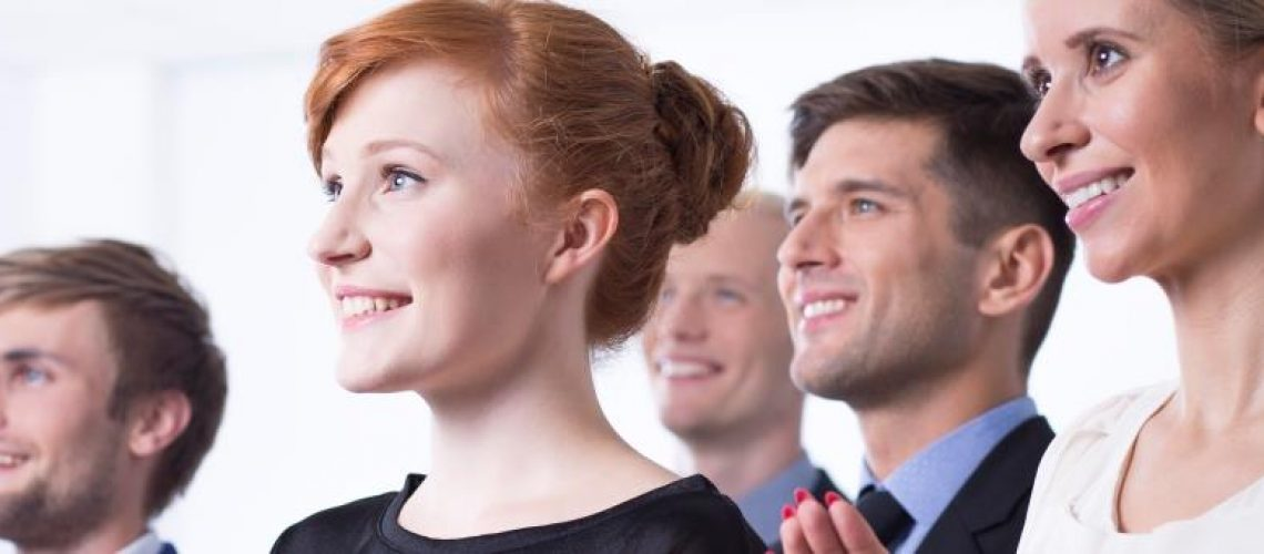 Elegant young business staff listening to business presentation