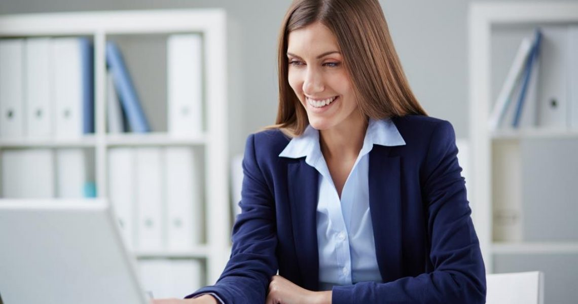 Young businesswoman networking in office