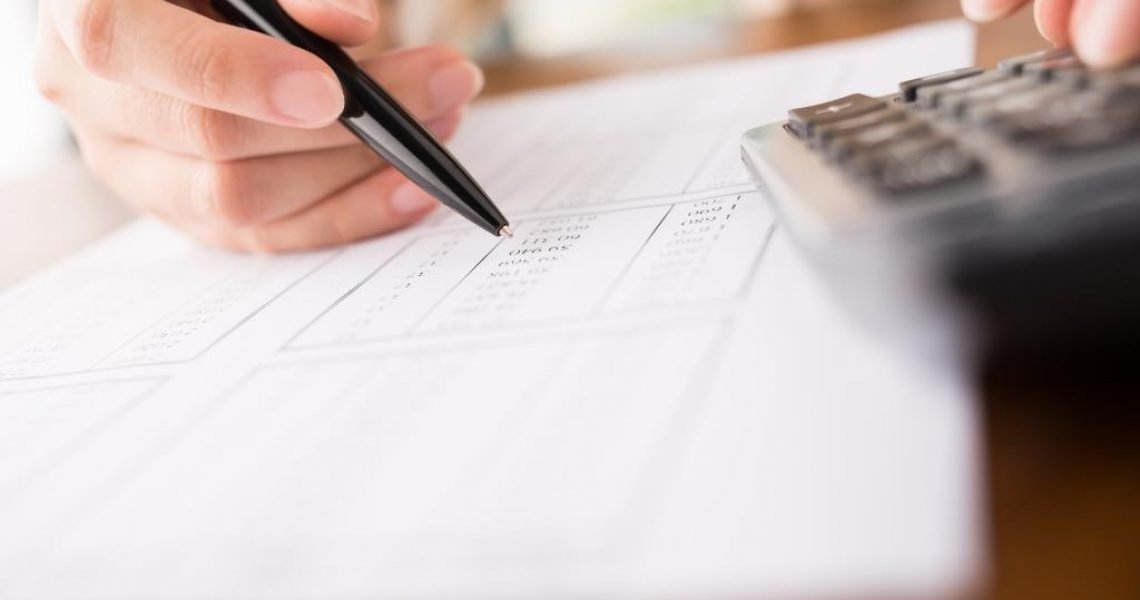 Close-up of accountant working on report