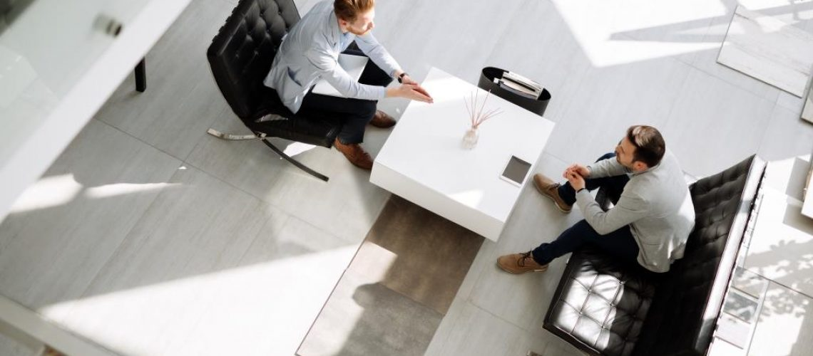 Business people discussing ideas in office lobby